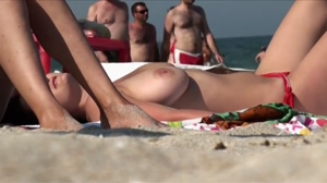 Topless Brunette On The Beach With Huge Boobs
