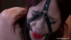 Jodi Taylor trying to push out her gag