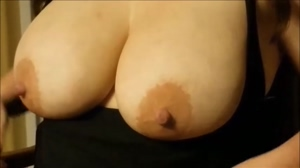 wife squeezing her big tits