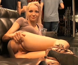 Beautiful blonde flashes her pussy