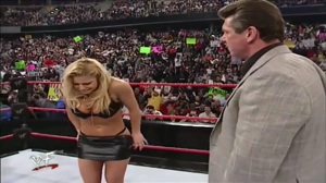 The controversial WWE moment were Vince McMahon forced Trish Stratus to strip and bark like a dog