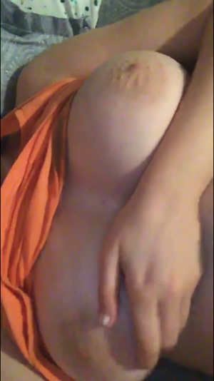 Girlfriend playing with her boobs