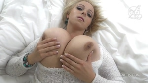 Agnetis Miracle plays with her huge boobs