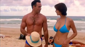 Catherine Bell realizes it's a topless beach