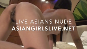 Asian girl on webcam asiangirlslive.net shows pussy