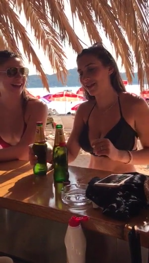 sexy sluts flash their tits at a beach bar