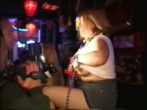 Girl at Mardi Gras lifts her shirt to show big tits and sprays breast milk