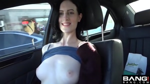 Showing off her tits in the car