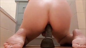 This white sissy riding her brand new black toy