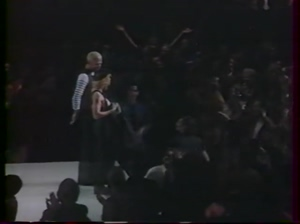 Young Madonna flashing her boobs on stage