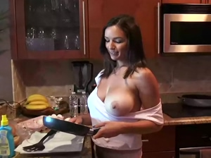 Revealing tits while cooking