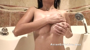 Asian girl in bath plays with her tits on webcam