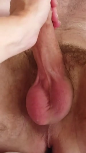 Wife stroking my cock .