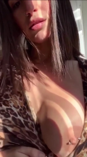 She reveals one sexy boob at a time