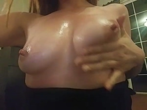 Playing with my oiled up tits :D