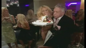 Naked Pamela Anderson surprises Hugh Hefner at his 82nd birthday party