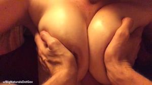 Fucking her big tits and rubbing her nipples with my dick