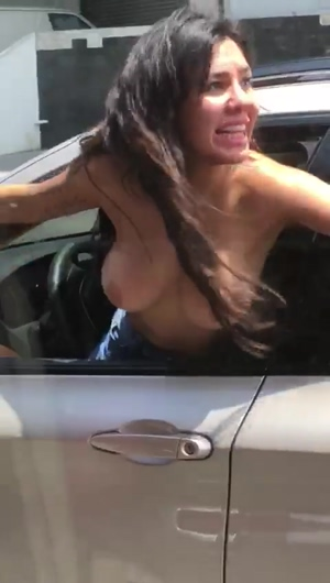 Angry woman shows her boobs to traffic