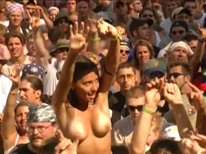 Cute girl showing off her boobs at Woodstock 99