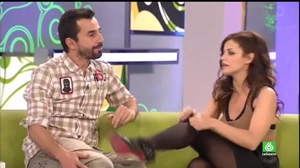 Marta Torne adjusting pantyhose on TV