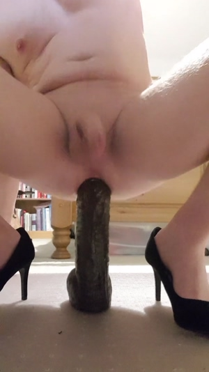 Sissy cumming hands free from big black dildo