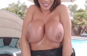 Big breasted MILF rubs with oil