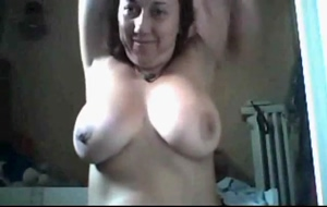 Busty Milf shows tan lines