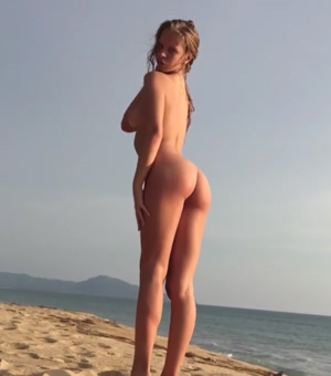 Dancing naked on the beach