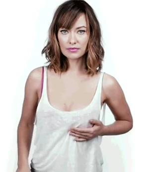 Olivia Wilde assessing her weight symmetry.