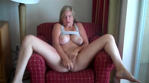Busty amateur blonde releases stress on couch