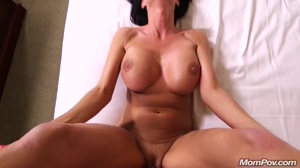 Milf with huge tits on her back getting fucked