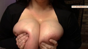 Using her huge tits to get the job done