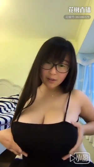 Cute Chinese cam-girl plays with her massive tits 🤯