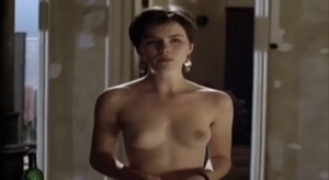 A young Kate Beckinsale undressing in the 1994 film, Uncovered