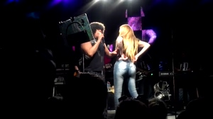 Blonde showing off tits and ass onstage