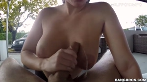 Finishing him on her tits in public