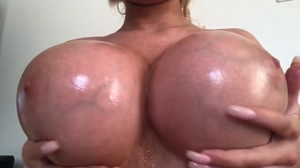 Amanda Toy massaging her huge, fake tits