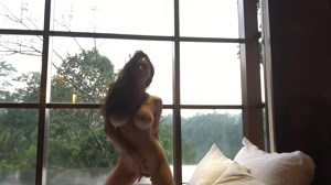 Naked lady in front of window