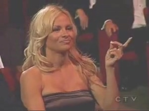Pamela Anderson and Trish Stratus kiss during an awards show in 2006.