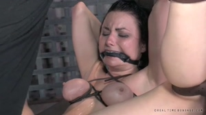 Biting down on her gag