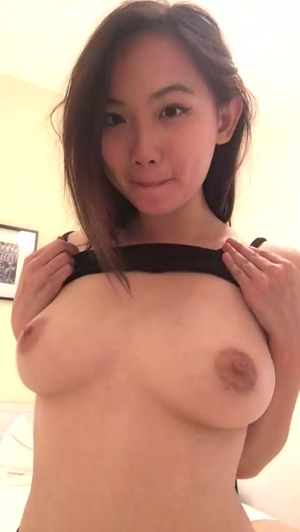 Asian Hottie Revealing Her Flawless Boobs