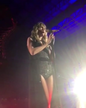 Taylor Swift disrobing on stage