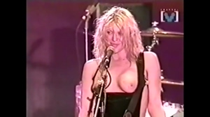 Courtney Love rocking out with her tits out