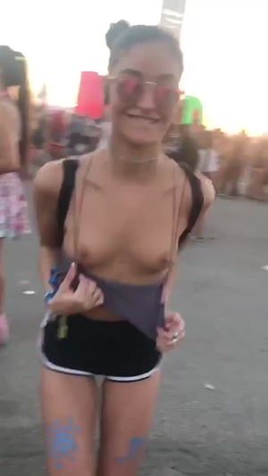 Showing off her tiny tits