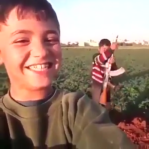 Kids playing with an AK-47