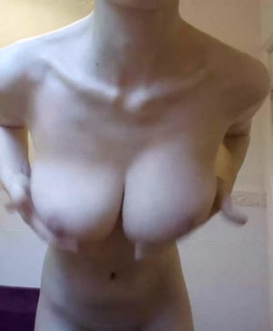 She plays with her boobs