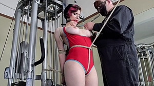 Iona Grace tied, drooling and stripped.