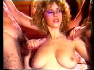 Busty blonde pulls two simultaneous cumshots across her tits