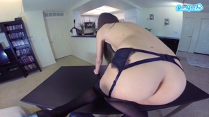 booping the camera with garters on