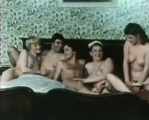 Vintage swingers in a bed